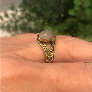 Stone ring in antique gold setting